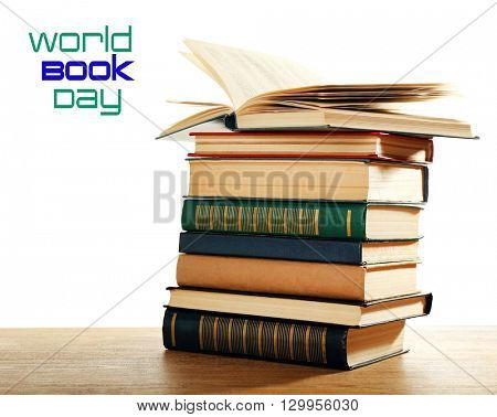 Old books on wooden table isolated on white. World Book Day poster
