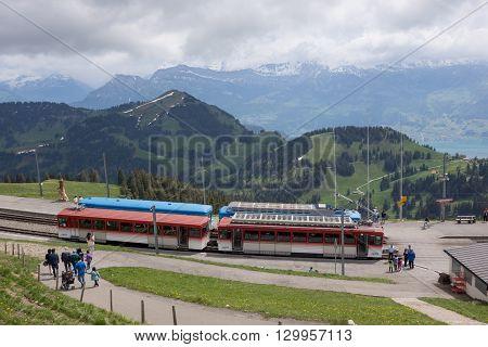Mount Rigi, Switzerland - June 9, 2013: Tourists about to board train on Mount Rigi near Lucerne, Switzerland.