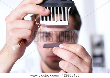 Man fixing electronic circuits closeup