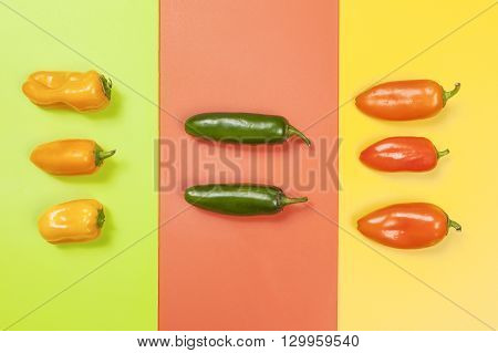 Peppers in color groups on vivid backgrounds.