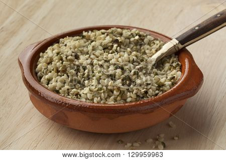 Raw peeled hemp seeds in a bowl