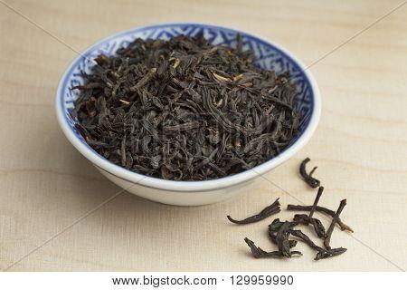 Chinese bowl with dried Nan-Yu tea