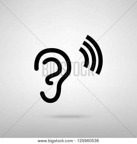 Human ear sign. Black with shadow on gray.