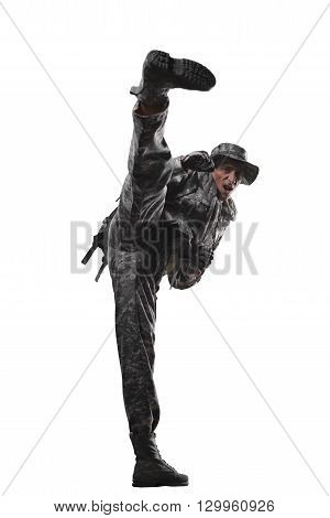 Military war conflict soldiers - Special forces soldier shows fighting techniques on a white background