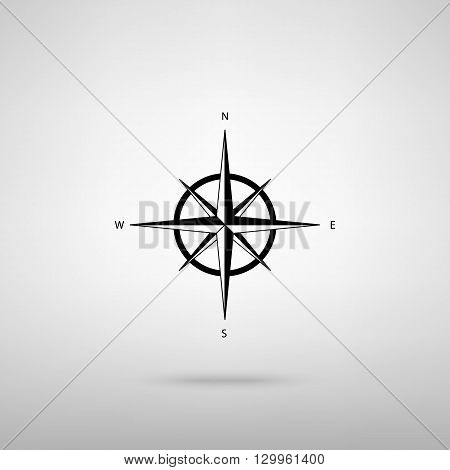 Wind rose sign. Black with shadow on gray.