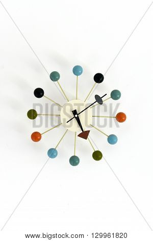 Retro atomic wall clock with coloured balls around edge