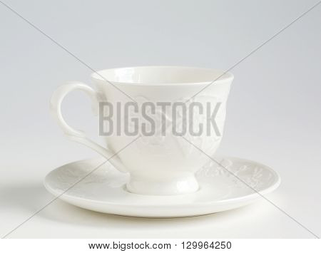 cup and saucer on a white background range tableware