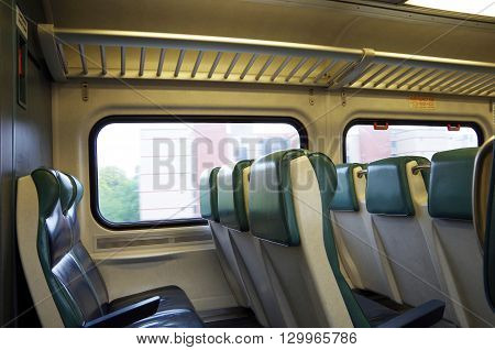 Interior of commuter train seats and windows