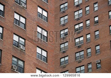 Looking up at a  detail view of a  nyc apartment buildings intersecting perspective