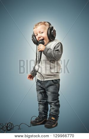 little child with microphone and headphone