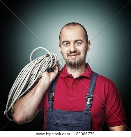 smiling and confident electrician
