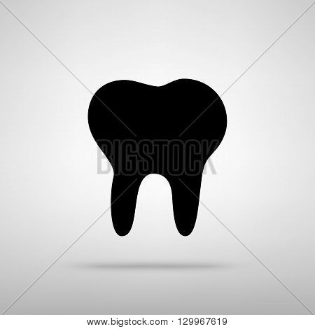 Tooth sign. Black with shadow on gray.