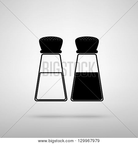 Salt and pepper sign. Black with shadow on gray.