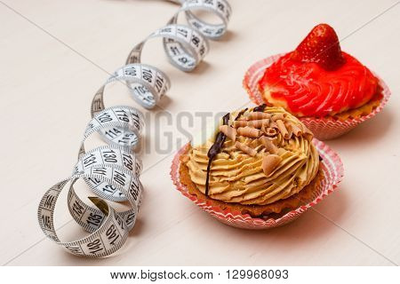Cupcakes With Measuring Tape On Table