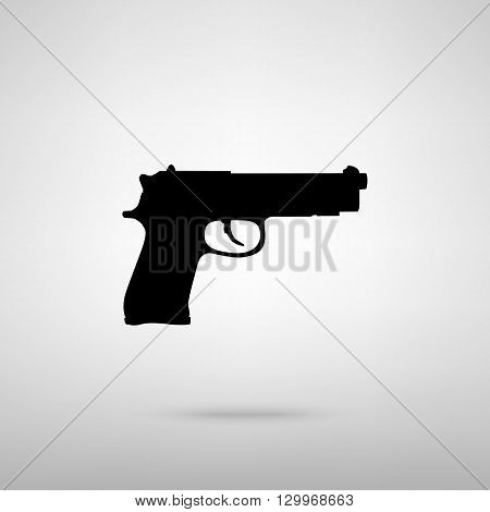 Gun sign. Black with shadow on gray.
