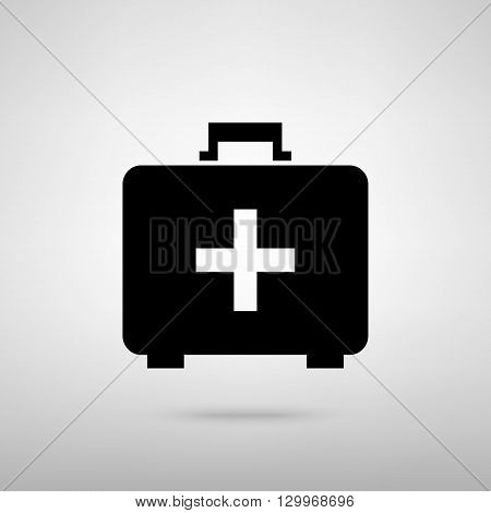 First aid box sign. Black with shadow on gray.