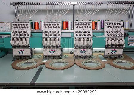 Kota Kinabalu, Sabah , Malaysia - April 25, 2016 : Embroidery machine brand TAJIMA, 4Head 12needle Textile Industry at Garment Manufacturers