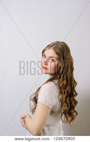 emotionless young woman posing on a white background