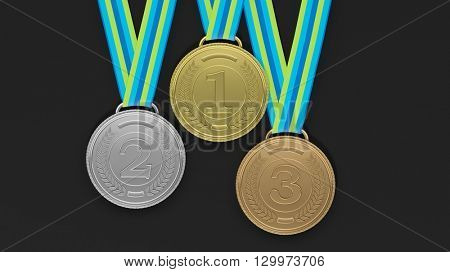 Close-up of 3D medals of silver,bronze and gold on black background.Isolated