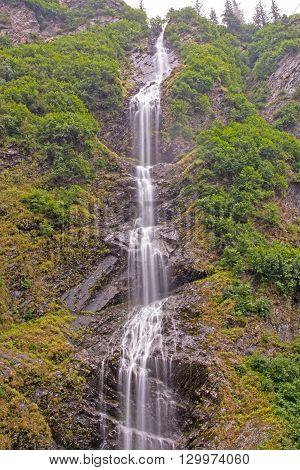 Dramatic Bridal Veil Falls in the Mist of Keystone Canyon near Valdez Alaska