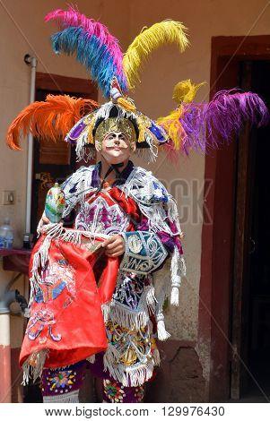 SAN ANTONIO DE PALOPO GUATEMALA APRIL 29 2016: Guatemalan fiesta Masked dancers in traditional dance costume Guatemala Dance of the Conqueror Central America