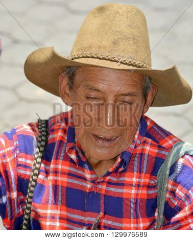 CHICHICASTENANGO GUSTEMALA APRIL 29 2016: Portrait of an old Mayan man. The Mayan people still make up a majority of the population in Guatemala,