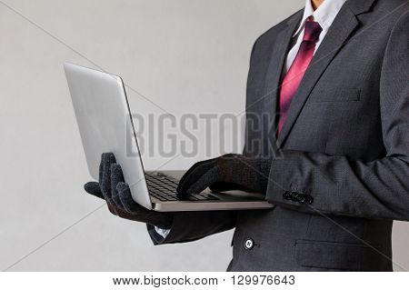 Business Man Wearing Gloves And Using Computer - Fraud, Hacker, Theft, Cyber Crime Concept