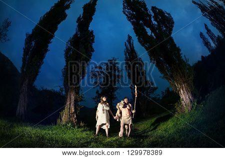 Caveman Couple In Dark Forest