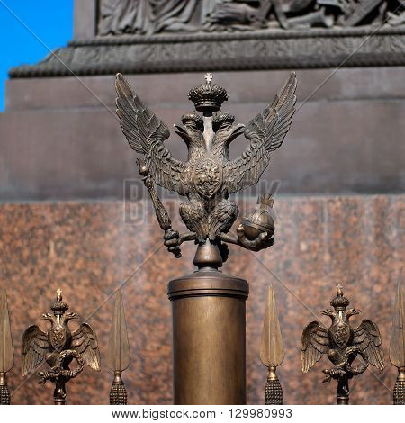 The double-headed eagle on the fence of the Alexander Column in front of the Winter Palace. The column was built by Auguste Montferrand. Russia. Petersburg.