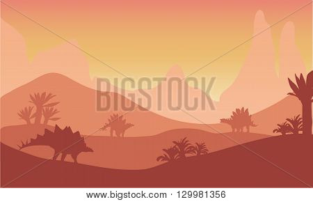 At sunset silhouette of stegosaurus with orannge backgrounds