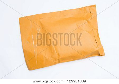 Old brown parcel post on white background