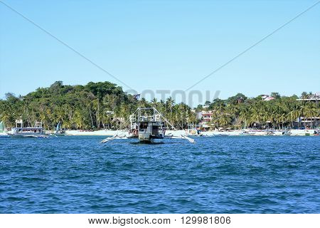 BORACAY PHILIPPINES - APRIL 7 2016: Boats off the coast of Boracay Island. The island is noted for is diving and water sports.