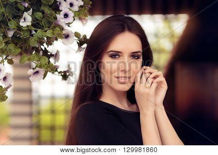Portrait of a Beautiful Woman Wearing Yellow Diamond Ring