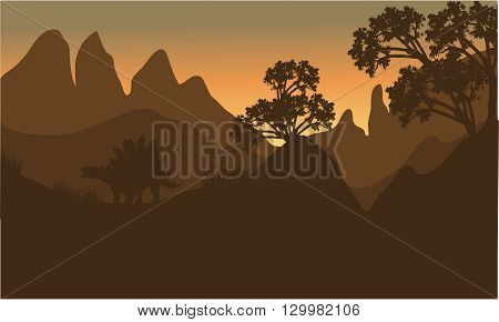 silhouette of stegosaurus in hills with brown backgrounds
