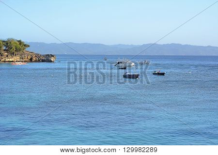 BORACAY PHILIPPINES - APRIL 7 2016: Boats off the coast of Boracay Island. The island is noted for its diving and water sports.