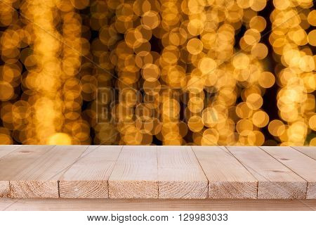 brown wood table top on bokeh abstract orange background - can be used for montage or display your products