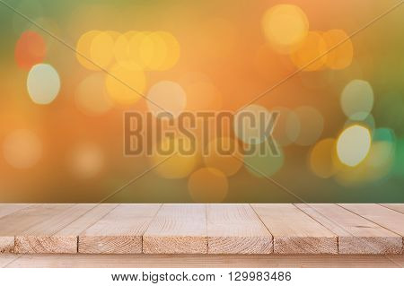 Brown Wood Table Top On Bokeh Abstract Orange Background - Can Be Used For Montage Or Display Your P