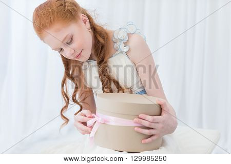 Girl Playing With Gift Box