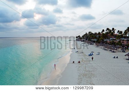 Aerial from a beautiful sunset at Manchebo beach on Aruba island in the Caribbean sea