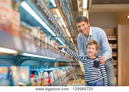 Dad and son in a store