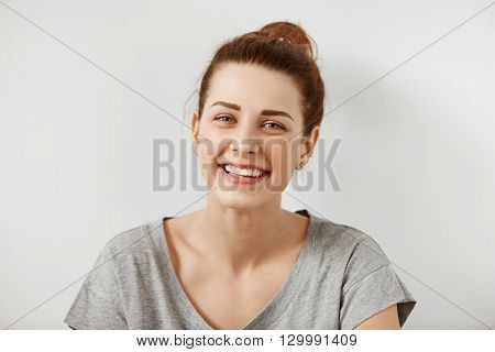 Close Up Shot Of Beautiful Young Redhead Woman In Gray T-shirt Looking With Cute Smile At The Camera