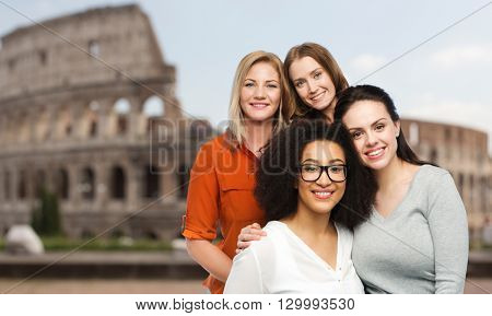 friendship, travel, tourism, diverse and people concept - group of happy different women in casual clothes over rome coliseum background