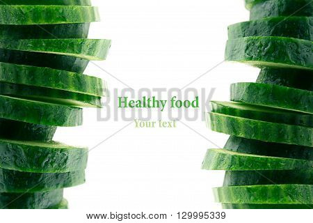 Pyramid from slices of cucumber. Frame with copy space. Concept art. Pattern. Food background.