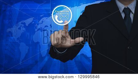 Businessman pressing telephone and mail icon button over map and city tower Contact us concept Elements of this image furnished by NASA
