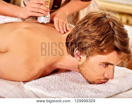 Man receiving electroporation back therapy at beauty salon. Used for  therapy of multifunctional electroporation  device.