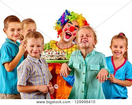 Clown holding cake on birthday with group children. Children playing with clown . Isolated.