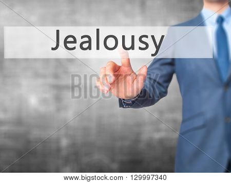 Jealousy - Businessman Hand Pressing Button On Touch Screen Interface.