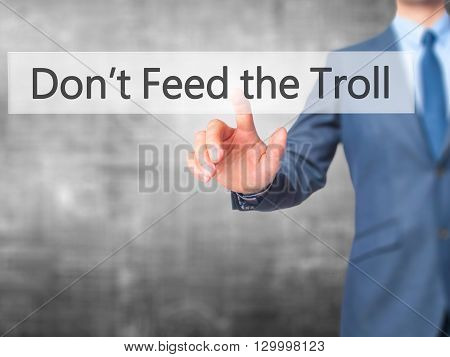 Don't Feed The Troll - Businessman Hand Pressing Button On Touch Screen Interface.