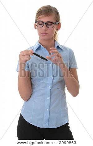 Portrait of a thoughtful young woman in blue shirt holding pen (secretary, student or young business woman)