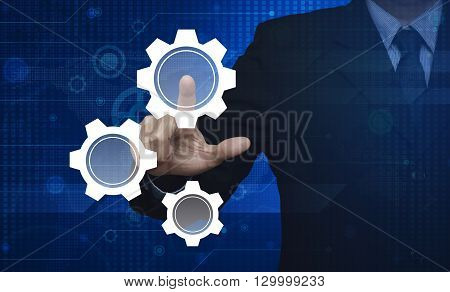 Businessman pressing gear icon with copy space on digital world map technology style Elements of this image furnished by NASA